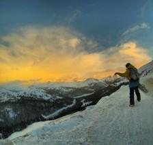 A snowboarder scouts prospective lines on Loveland Pass, Christmas morning. Loveland Pass, CO. December, 2014