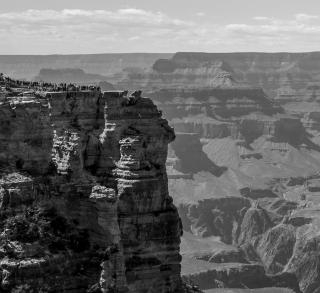 Visitors of Grand Canyon National Park take in the beauty of the South Rim. Grand Canyon National Park, AZ. May, 2017