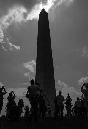 Photographers gather around the base of the Washington Monument during the solar eclipse. Washington, D.C. August, 2017.