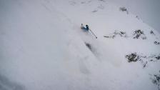 "A skier enjoys some turns down Big Sky's ""Big Couloir"" run. Big Sky, MT. March, 2016"