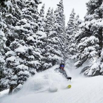 "A skier enjoys some bottomless turns on Breckenridge's Peak 8 after a 19"" snowfall. Breckenridge, CO. December, 2016."