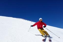 A skier descends off of Breckenridge's Peak 6. Breckenridge, CO. April, 2017.