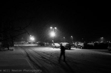 A Breckenridge local walks towards the liquor store on a snowy winter evening. Breckenridge, CO. December, 2016.