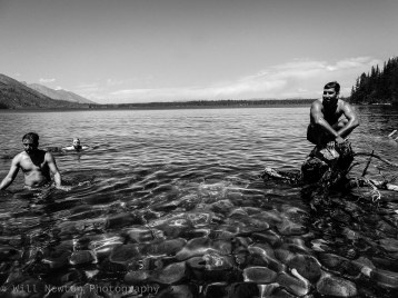 Visitors of Grand Teton National Park take a swim in Jenny Lake to cool off after a long hike in the wilderness. Grand Teton National Park, WY. July, 2017