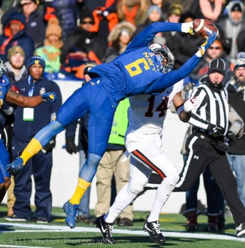 #6 Sean Williams of Navy steals the ball from #14 Andre Levrone of UVA during action of The Military Bowl, December 28, 2017 in Annapolis, MD