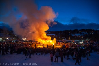 Festival goers enjoy a bonfire after the Ullr Fest parade down Main st. in Breckenridge, CO, on January 11, 2017.