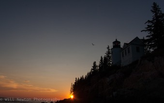 The sun sets behind Bass Harbor Lighthouse in Acadia National Park, summer 2017.
