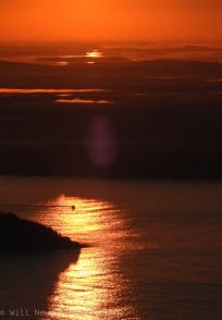 The Sun rises over Bar Harbor, Maine seen from the top of Cadillac Mountain in Acadia National Park last summer, 2017.