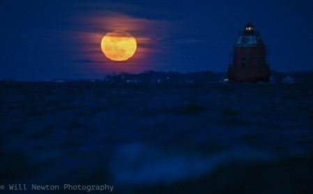 The super blue blood moon is seen rising behind the Sandy Point lighthouse on January 31st, 2018.