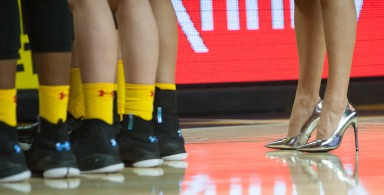 Members of the UMD Women's basketball team meet during a timeout during game time action against Purdue on February 15, 2018.