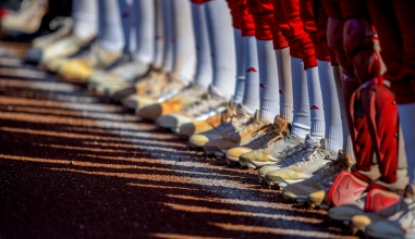 Members of the Miami University softball team line up prior to game time against University of Maryland.