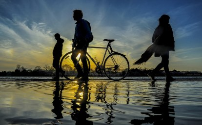 DC commuters walk through a flooded Tidal Basin, April 9th, 2018.