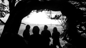 A group of women look out towards the San Francisco bay on a rainy afternoon, May, 2015.