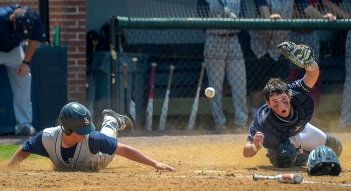 Baserunner Chase Verdery(8) of St. Albans collides with Georgetown Prep catcher Max Kaye(12) to score in the second inning of play during the IAC championship baseball game in Bethesda, MD on May 12, 2018. (Photo by Will Newton for The Washington Post)