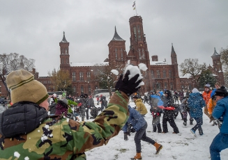 Patrons of Washington, D.C take part in an organized snowball fight after a snowfall blanketed the region on March 21st, 2018. (Photo by Will Newton)