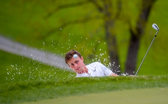 A Penn State golfer chips out of the sand trap during the Big 10 golf tournament at the Baltimore Country Club on April 27th, 2018 in Lutherville, MD. (Photo by Will Newton)