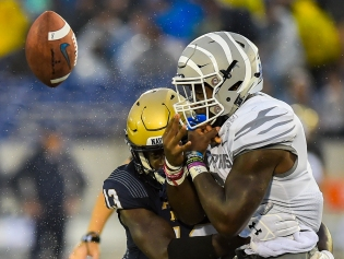 Juan Hailey (13) of Navy, forces Patrick Taylor Jr. (6) of Memphis, to fumble the football in the fourth quarter to give Navy the football to score the winning touchdown against Memphis at Navy-Marine Corps Memorial Stadium in Annapolis, MD on September 8, 2018. Photo by Will Newton