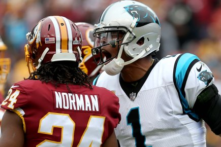 Cam Newton #1 of the Carolina Panthers reacts to Josh Norman #24 of the Washington Redskins after a play in the third quarter at FedExField on October 14, 2018 in Landover, Maryland. (Photo by Will Newton/Getty Images)