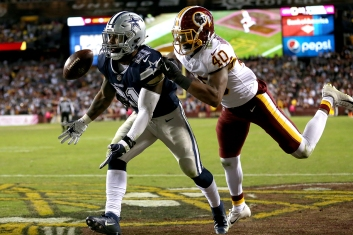 Josh Harvey-Clemons #40 of the Washington Redskins defends a pass intended for Ezekiel Elliott #21 of the Dallas Cowboys during the second half at FedExField on October 21, 2018 in Landover, Maryland. (Photo by Will Newton/Getty Images)