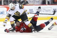 Jonathan Marchessault #81 of the Vegas Golden Knights and Dmitry Orlov #9 of the Washington Capitals battle for the puck during the third period at Capital One Arena on October 10, 2018 in Washington, DC. (Photo by Will Newton/Getty Images)