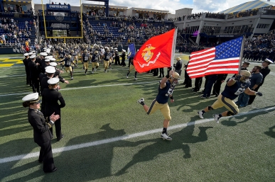 The Navy Midshipmen run on to the field before playing against the Houston Cougars at Navy-Marines Memorial Stadium on October 20, 2018 in Annapolis, Maryland. (Photo by Will Newton/Getty Images)