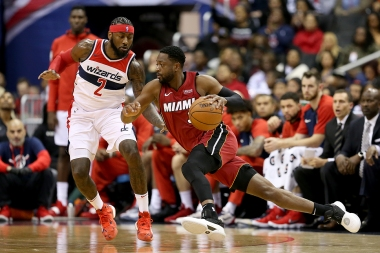 Dwyane Wade #3 of the Miami Heat dribbles past John Wall #2 of the Washington Wizards during the second half at Capital One Arena on October 18, 2018 in Washington, DC. NOTE TO USER: User expressly acknowledges and agrees that, by downloading and or using this photograph, User is consenting to the terms and conditions of the Getty Images License Agreement. (Photo by Will Newton/Getty Images)