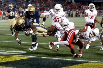 Myles Fells #23 of the Navy Midshipmen scores a touchdown against the Houston Cougars during the second half at Navy-Marines Memorial Stadium on October 20, 2018 in Annapolis, Maryland. (Photo by Will Newton/Getty Images)