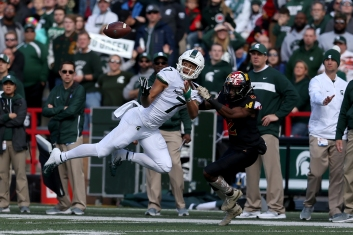 COLLEGE PARK, MD - NOVEMBER 03: Cody White #7 of the Michigan State Spartans catches a pass against RaVon Davis #2 of the Maryland Terrapins during the first half at Capital One Field on November 3, 2018 in College Park, Maryland. (Photo by Will Newton/Getty Images)