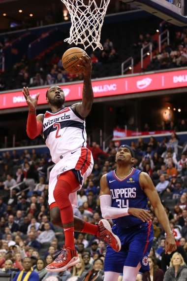 WASHINGTON, DC - NOVEMBER 20: John Wall #2 of the Washington Wizards shoots in front of Tobias Harris #34 of the LA Clippers during the second half at Capital One Arena on November 20, 2018 in Washington, DC. (Photo by Will Newton/Getty Images)