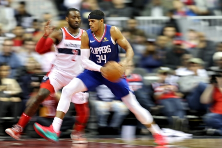 WASHINGTON, DC - NOVEMBER 20: Tobias Harris #34 of the LA Clippers is defended by John Wall #2 of the Washington Wizards during the second half at Capital One Arena on November 20, 2018 in Washington, DC. (Photo by Will Newton/Getty Images)