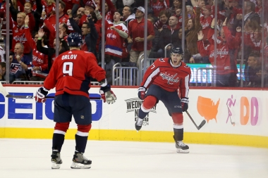 WASHINGTON, DC - NOVEMBER 07: T.J. Oshie #77 of the Washington Capitals celebrates with Dmitry Orlov #9 of the Washington Capitals after scoring the game winning goal against the Pittsburgh Penguins during the third period at Capital One Arena on November 7, 2018 in Washington, DC. (Photo by Will Newton/Getty Images)