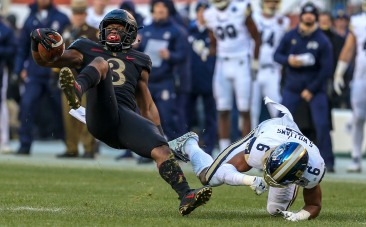 PHILADELPHIA, PA - DECEMBER 8: Jordan Asberry #3 of the Army Black Knights is tackled by Sean Williams #6 of the Navy Midshipmen during the first half at Lincoln Financial Field in Philadelphia, PA on December 8, 2018. (Photo by Will Newton)