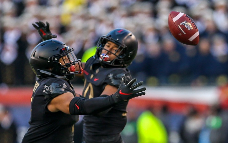 PHILADELPHIA, PA - DECEMBER 8: Mike Reynolds #10 of the Army Black Knights tips the ball for a Jaylon McClinton #7 of the Army Black Knights interception during the first half against the Navy Midshipmen at Lincoln Financial Field in Philadelphia, PA on December 8, 2018. (Photo by Will Newton)
