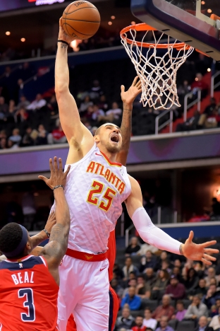 WASHINGTON, DC - JANUARY 2: Alex Len #25 of the Atlanta Hawks dunks over Bradley Beal #3 of the Washington Wizards during the first half at Capital One Arena on January 2, 2019 in Washington, DC. NOTE TO USER: User expressly acknowledges and agrees that, by downloading and or using this photograph, User is consenting to the terms and conditions of the Getty Images License Agreement. (Photo by Will Newton/Getty Images)
