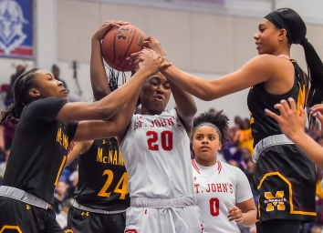 WASHINGTON, DC - FEBRUARY 25: Malu Tshitenge-Mutombo (20) of St. John's battles Liatu King (1), Madison Scott (24) and Jakia Brown-Turner (11) of Bishop McNamara for the ball during the WCAC championship game at Bender Arena on February 25, 2019 in Washington, DC. (Photo by Will Newton for The Washington Post)