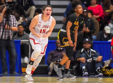 WASHINGTON, DC - FEBRUARY 25: Carly Rivera (15) of St. John's celebrates after making a three point shot against the Bishop McNamara Mustangs during the second half of the WCAC championship game at Bender Arena on February 25, 2019 in Washington, DC. (Photo by Will Newton for The Washington Post)