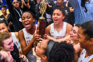 WASHINGTON, DC - FEBRUARY 25: Malu Tshitenge-Mutombo (20) and Azzi Fudd (35) of St. John's celebrate with teammates after defeating Bishop McNamara in the WCAC championship game at Bender Arena on February 25, 2019 in Washington, DC. (Photo by Will Newton for The Washington Post)