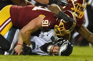LANDOVER, MD - DECEMBER 30: Nick Foles #9 of the Philadelphia Eagles is sacked by Ryan Kerrigan #91 of the Washington Redskins during the second half at FedExField on December 30, 2018 in Landover, Maryland. (Photo by Will Newton/Getty Images)