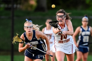 COLLEGE PARK, MD - MAY 13: Kayla Rieu #19 of Good Counsel and Aubrey Williams #14 of Bishop Ireton battle for a loose ball during the WCAC final in College Park, MD on May 13, 2019. (Photo by Will Newton for The Washington Post)