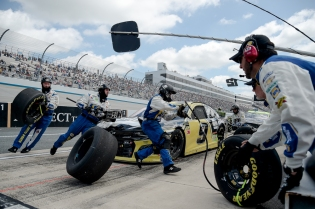 Driver Chase Elliott (9) pits during the NASCAR Cup Series auto race, Monday, May 6, 2019, at Dover International Speedway in Dover, Del. (AP Photo/Will Newton)