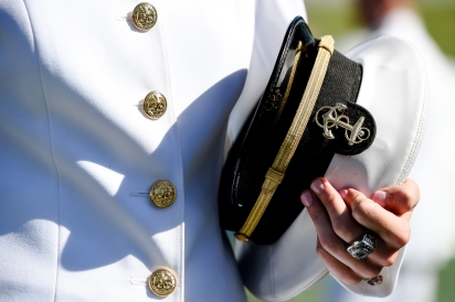 A U.S Naval Academy midshipmen holds their hat while processing in to the Academy's graduation and commissioning ceremony, Friday, May 24, 2019, in Annapolis, Md. (AP Photo/Will Newton)
