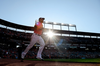 BALTIMORE, MD - JULY 13: Rio Ruiz #14 of the Baltimore Orioles runs on to the field prior to game two of a doubleheader against the Tampa Bay Rays at Oriole Park at Camden Yards on July 13, 2019 in Baltimore, Maryland. (Photo by Will Newton/Getty Images)