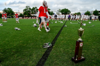 COLLEGE PARK, MD - MAY 13: Ryan Whitty #9 of St. John's walks past the WCAC Lacrosse trophy after losing to Gonzaga during the WCAC final in College Park, MD on May 13, 2019. (Photo by Will Newton for The Washington Post)