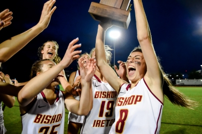 COLLEGE PARK, MD - MAY 13: Anna cate Gately #8 of Bishop Ireton hoists the WCAC trophy with teammates after defeating Good Counsel for the WCAC final in College Park, MD on May 13, 2019. (Photo by Will Newton for The Washington Post)