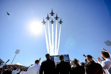 The Blue Angels flight demonstration team flies over graduating members of the U.S. Naval Academy during the Academy's graduation and commissioning ceremony, Friday, May 24, 2019, in Annapolis, Md. (AP Photo/Will Newton)
