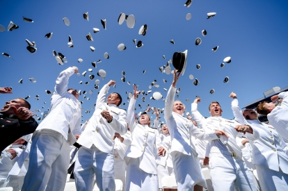 Graduating members of the U.S. Naval Academy celebrate at the end of the Academy's graduation and commissioning ceremony, Friday, May 24, 2019, in Annapolis, Md. (AP Photo/Will Newton)
