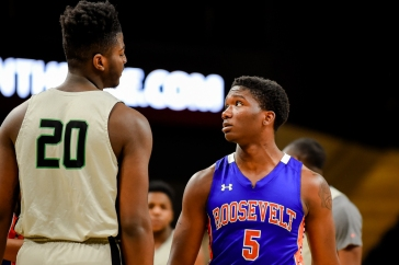 WASHINGTON, DC - FEBRUARY 17: Makhi Mitchell (20) of Wilson High School and Darius Buchanan (5) of Roosevelt High School exchange words during the first half at the D.C. Entertainment and Sports Arena on February 17, 2019 in Washington, DC. (Photo by Will Newton for The Washington Post)