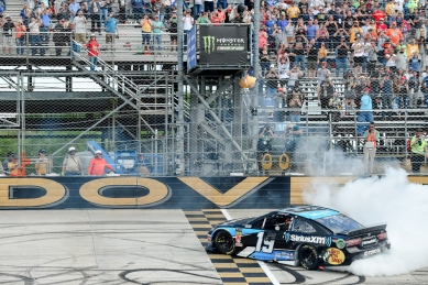 Driver Martin Truex Jr. (19) performs a burnout after winning the NASCAR Cup Series auto race, Monday, May 6, 2019, at Dover International Speedway in Dover, Del. (AP Photo/Will Newton)