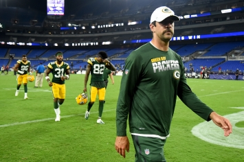 BALTIMORE, MD - AUGUST 15: Aaron Rodgers #12 of the Green Bay Packers walks off the field after a preseason game against the Baltimore Ravens at M&T Bank Stadium on August 15, 2019 in Baltimore, Maryland. (Photo by Will Newton/Getty Images)