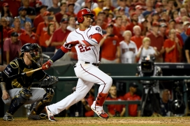 WASHINGTON, DC - OCTOBER 01: Juan Soto #22 of the Washington Nationals hits a single to right field to score 3 runs off of an error by Trent Grisham #2 of the Milwaukee Brewers during the eighth inning in the National League Wild Card game at Nationals Park on October 01, 2019 in Washington, DC. (Photo by Will Newton/Getty Images)
